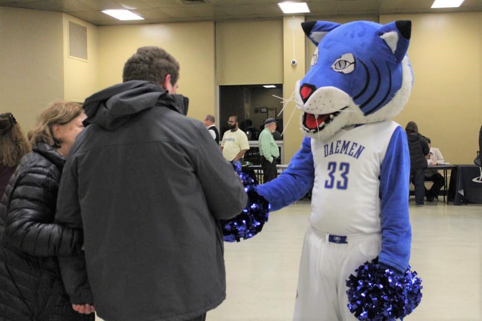 daemen wildcat mascot and a parent