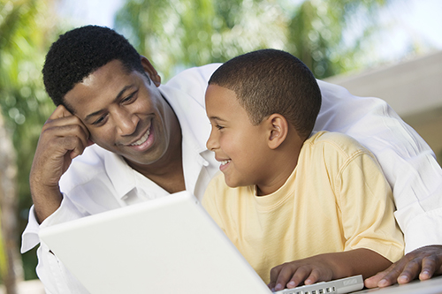 Father and son on a laptop