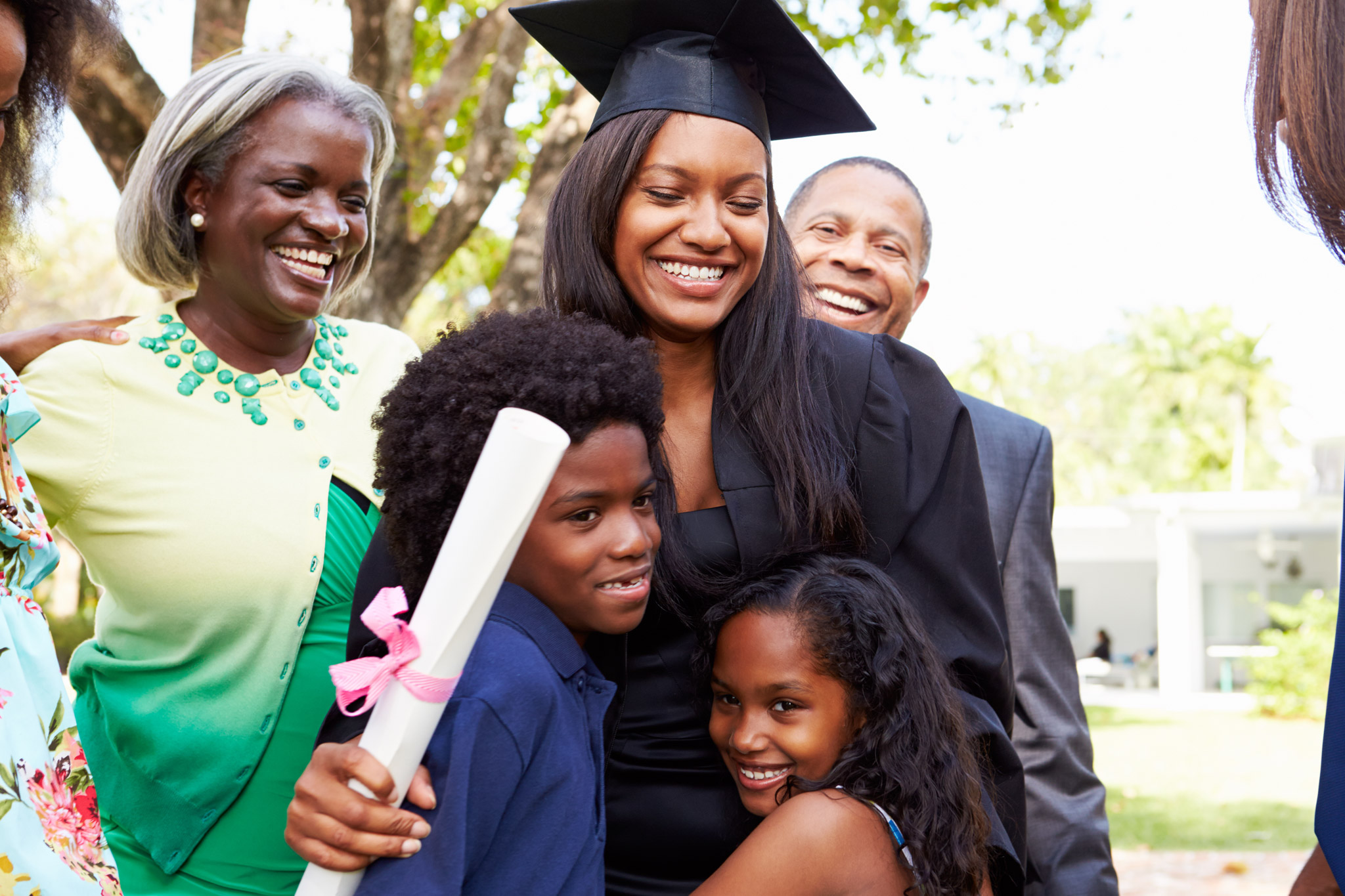 Happy graduate with her family