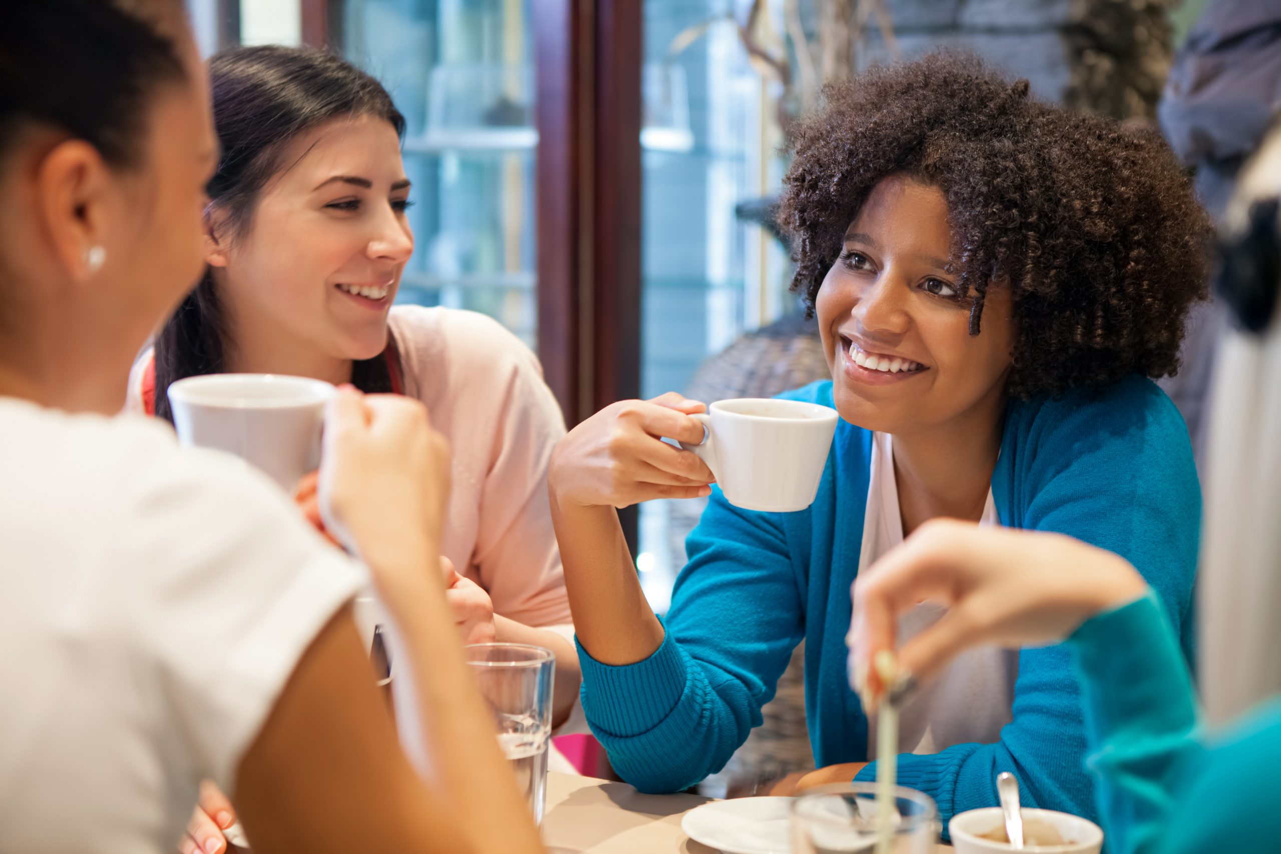 Group of ladies drinking coffee and talking