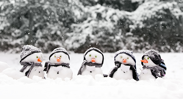 five snowmen in the snow
