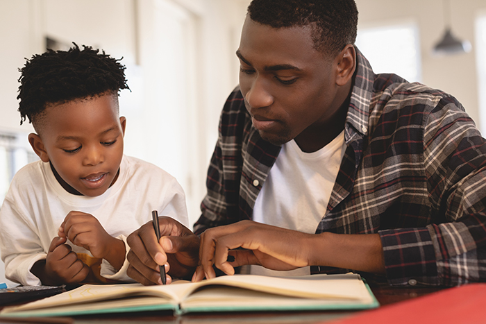 father and son reading a story