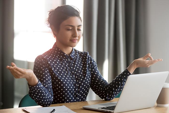 Woman meditating at computer
