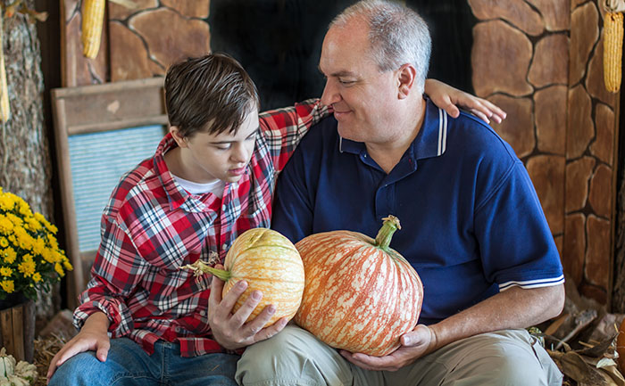 boy and father with pumpkins