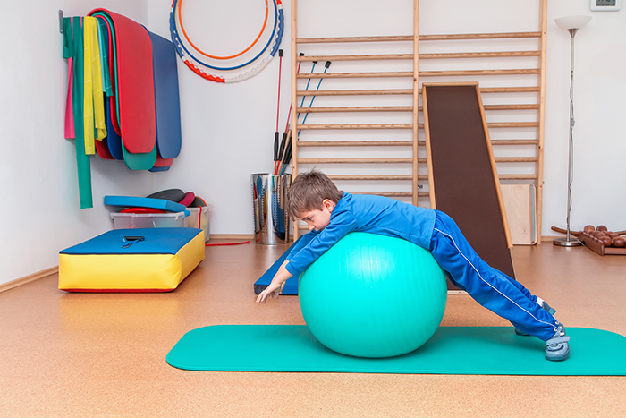 boy on an exercise ball