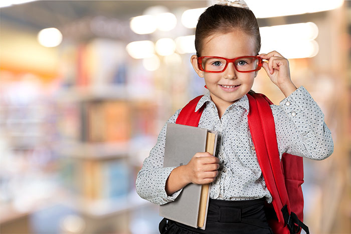 girl with glasses and book