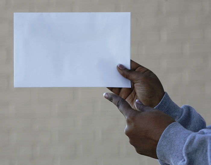 person holding up a sheet of paper