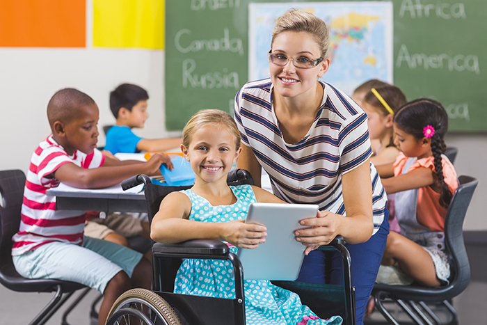 teacher with student in a wheelchair