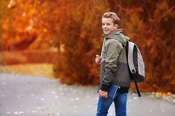kid walking down street