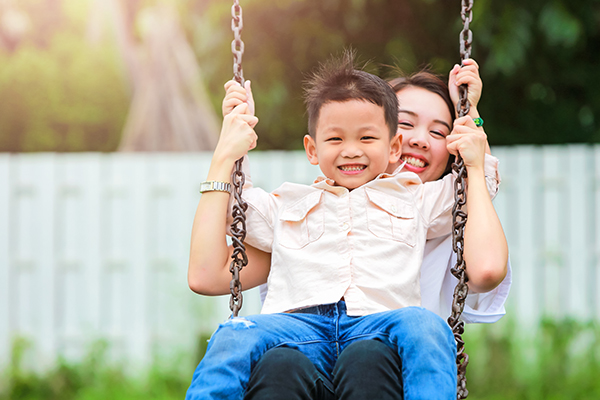 mom and child on swing