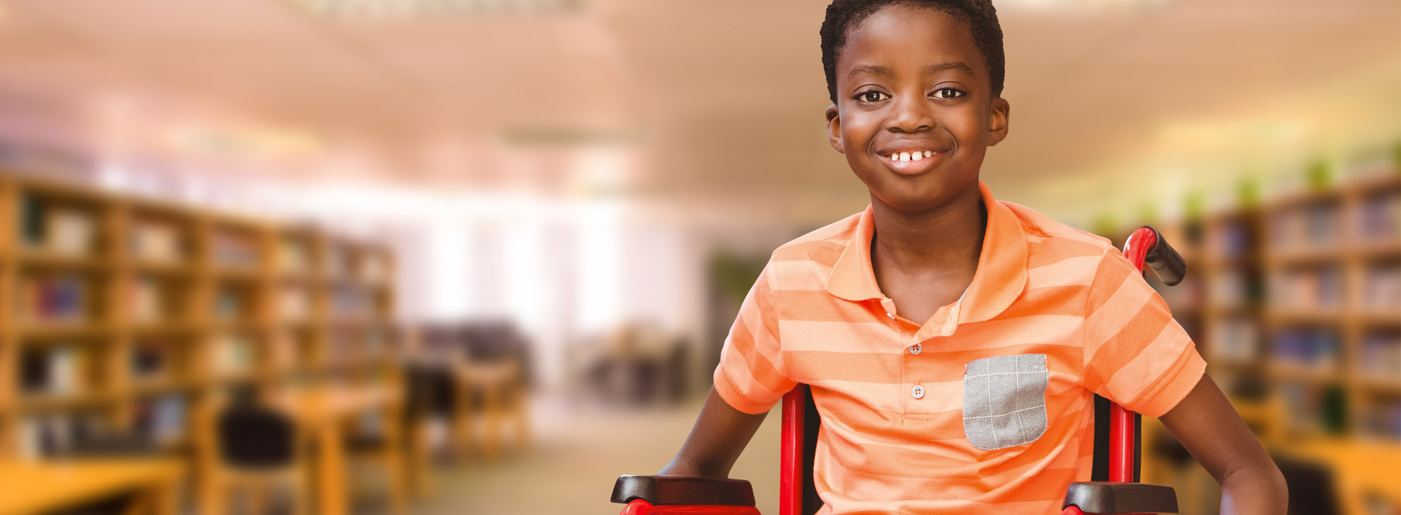 boy in a wheelchair in a library