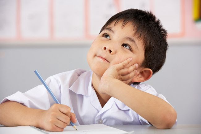 boy thinks in school